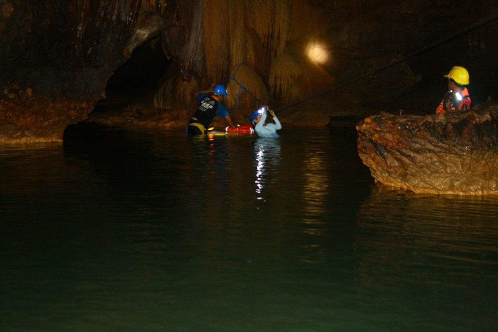 crossing the underground river in capisaan cave